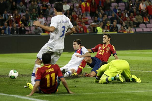 Spain's Jesus Navas, right, scores his side's second goal past Chile's Eugenio Mena, third right, and goalkeeper Claudio Bravo, right, as Spain's Pedro Rodriguez (11), and Chile's Marcos Gonzalez (3)