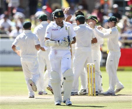 South Africa's Smith leaves the pitch as Australia celebrate his wicket during the fourth day of the third cricket test match at Newlands Stadium in Cape Town