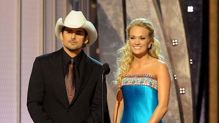 Hosts Brad Paisley and Carrie Underwood speak on stage during the 42nd Annual CMA Awards at the Sommet Center on November 12, 2008 in Nashville, Tennessee.