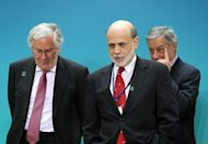 US Federal Reserve Board Chairman Ben Bernanke (2nd L) walks with Governor of the Bank of England Mervyn King (L) prior to the family photo of G-20 finance ministers and central bank governors at the IMF headquarters, April 20, in Washington, DC. The IMF raised $430 billion in new funds for crisis intervention Friday, with China and other emerging economic giants taking part