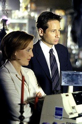 "Agents Scully (Gillian Anderson, L) and Mulder (David Duchovny, R) investigate a series of bizarre and connected murders with characteristics  pointing to the occult in the ""Theef"" episode of Fox's Th"