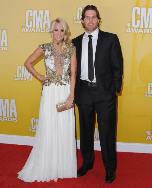 Carrie Underwood and husband Mike Fisher attend the 46th annual CMA Awards at the Bridgestone Arena in Nashville on November 1, 2012  -- Getty Premium
