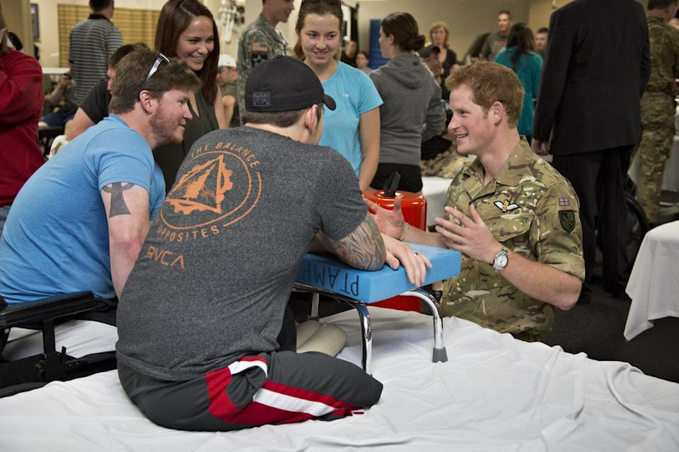Wearing his British Army uniform, Britain's Prince Harry visits with wounded warriors undergoing physical therapy at the Military Advanced Training Center at Walter Reed National Military Medical Center in Bethesda, Md., just outside Washington, Friday, May 10, 2013.   (AP Photo/J. Scott Applewhite, Pool)