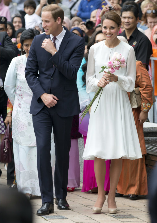 Prince William and his wife Kate, the Duke and Duchess of Cambridge take a walk through a central city park in Kuala Lumpur, Malaysia, Friday, Sept. 14, 2012. Prince William and Kate are on a nine-day