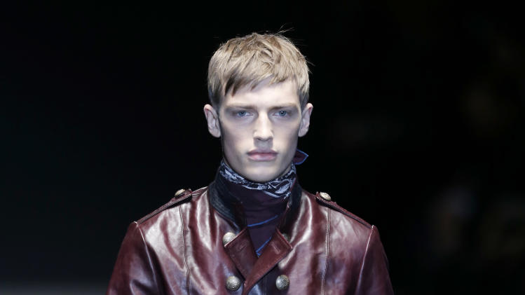 A model wears a creation for Gucci men's Fall-Winter 2013-14 collection, part of the Milan Fashion Week, unveiled in Milan, Italy, Monday, Jan. 14, 2013. (AP Photo/Antonio Calanni)
