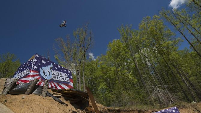 IMAGE DISTRIBUTED FOR NITRO CIRCUS - 29 yr-old Nitro Circus athlete Josh Sheehan completes the world's first triple back flip on an FMX motor bike at Pastranaland on Tuesday, April 28, 2015 in Davidsonville, Md.  Sheehan broke the double backflip record set in 2006 by Nitro Circus co-founder Travis Pastrana who was also on hand to witness the event. (Nick Wass/AP Images for Nitro Circus)
