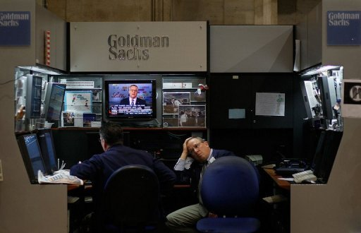 &lt;p&gt;Traders work at the Goldman Sachs booth on the floor of the New York Stock Exchange, 2010. Global economic turbulence hit the bottom line at Wall Street banking titan Goldman Sachs, with second quarter profits falling 12 percent from a year earlier&lt;/p&gt;