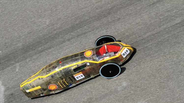 COMMERCIAL IMAGE - In this photo released by AP Images for Shell, The #19 MMU Grune Welt, Gasoline Prototype, from Multimedia University Melaka Campus in Malaysia runs a lap on day two of the Shell Eco-marathon Challenge Asia at Sepang International Circuit in Kuala Lumpur, Wednesday, July 5, 2012. Students from Asia and the Middle East have come together to compete in the four-day event.(Peter Lim/AP Images for Shell)