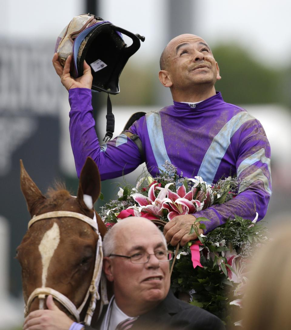 Mike Smith and owner Ed Stanco celebrate after Smith rode Princess of Sylmar to a win in the 139th Kentucky Oaks at Churchill Downs Friday, May 3, 2013, in Louisville, Ky.  (AP Photo/David Goldman)