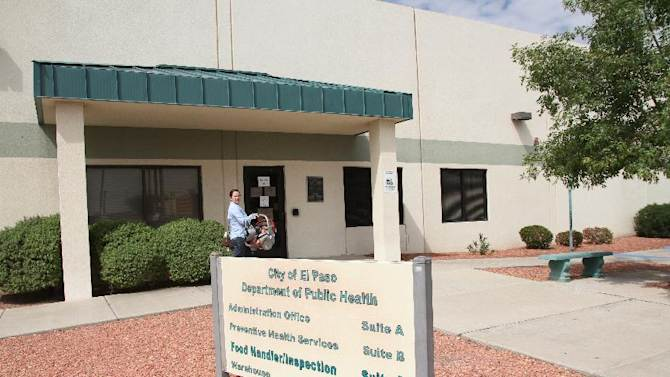 April Hernandez takes her son Rogelio Tovar for tuberculosis testing at the El Paso Department of Public Health in El Paso, Texas, Tuesday, Sept. 23,  2014. Hernandez's baby and about 750 other infants were exposed to a healthcare worker infected with tuberculosis over the past year prompting health authorities to screen all those children for the disease. (AP Photo/Juan Carlos Llorca)