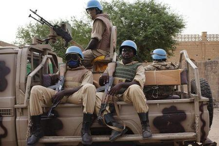 UN peacekeepers from Burkina Faso patrol on election day in Timbuktu