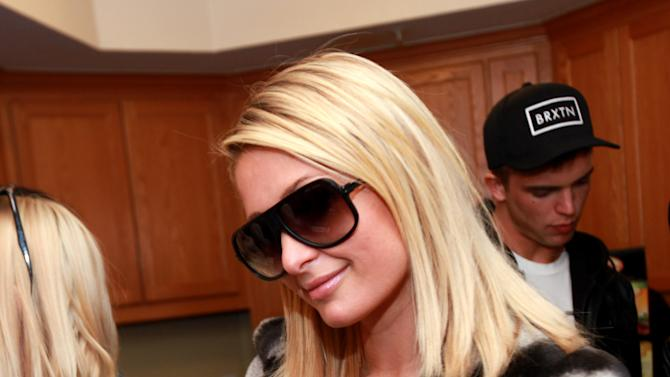 Paris Hilton is seen at the Fender Music lodge during the Sundance Film Festival on Sunday, Jan. 20, 2013, in Park City, Utah. (Photo by Barry Brecheisen/Invision for Fender/AP Images)