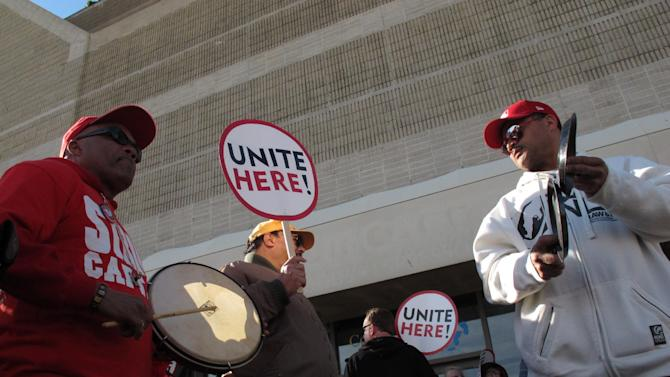 Tropicana employees Julio Laranque, left, and Rudy Castillo, right, bang on percussion instruments at a protest on the Atlantic City N.J. Boardwalk against the Tropicana Casino and Resort on April 5, 2012. The union is fighting the casino's attempt to terminate a pension plan for workers in favor of direct cash payments to them. (AP Photo/Wayne Parry)