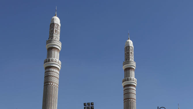 FILE - In this Friday, Jan. 8, 2010 file photo, Yemeni men walk toward the Saleh mosque to attend the Friday prayers at the capital Sanaa, Yemen. Saleh has set up an office in the giant, extravagant Sanaa mosque that he built during his rule and that bears his name, just around the corner from the presidential palace. There he meets with loyalists and powerful tribal leaders who back him. The result is a constant confrontation between Saleh's backers and the new president, Abed Rabbo Mansour Hadi. (AP Photo/Nasser Nasser, File)