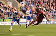 Demba Ba, right, scores his and Newcastle's second goal against Reading