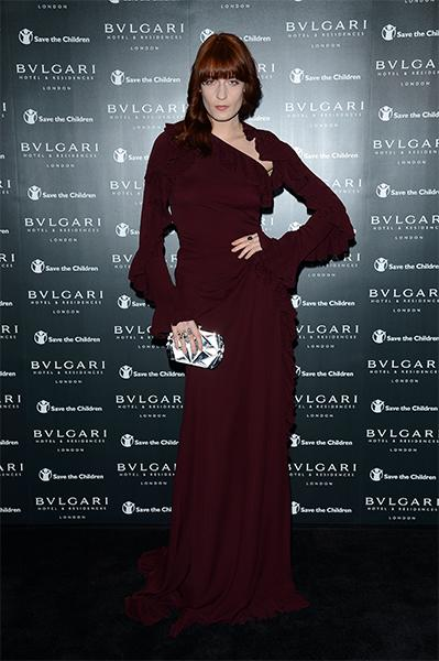 The red-headed beauty matched her hair to her silk georgette Gucci gown at the Bulgari Hotel opening party in London in June. A Bulgari Serpenti clutch and ring were the perfect, subtle accents.  (Pho