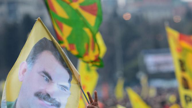 "In this photo taken Sunday, March 17, 2013, Kurds wave banners depicting imprisoned Kurdish rebel leader Abdullah Ocalan in Istanbul, Turkey. Imprisoned Kurdish rebel leader Abdullah Ocalan, in a message relayed by Kurdish legislators who visited him on his prison island, said Monday, March 18 that peace talks with Turkey are making ""positive progress"" and that he plans to make a ""historic"" announcement to coincide with a Kurdish spring festival. (AP Photo)"