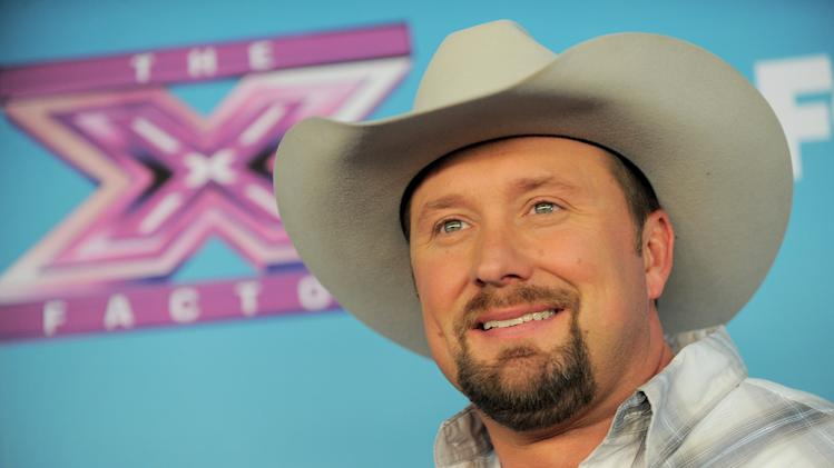 "Tate Stevens attends the ""The X Factor"" season finale at CBS Television City on Thursday, Dec. 20, 2012, in Los Angeles. (Photo by Jordan Strauss/Invision/AP)"