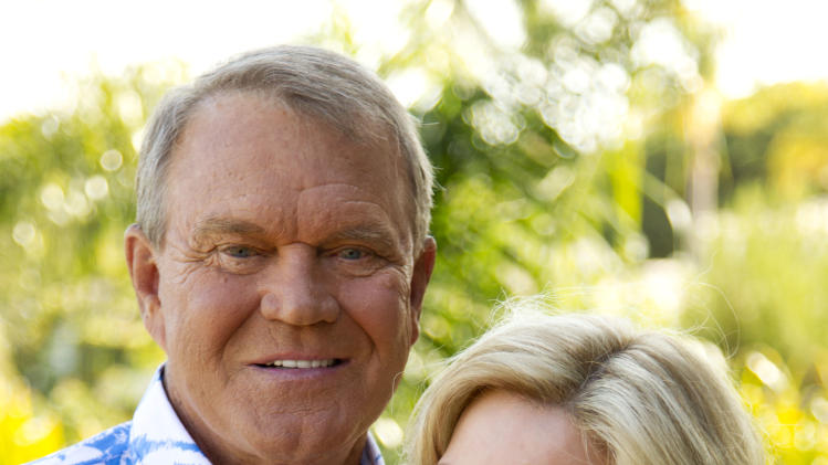 In this July 27, 2011 photo, musician Glen Campbell poses for a portrait with his wife Kim in Malibu, Calif. Campbell, who was diagnosed with Alzheimer's disease, is planning a farewell tour before retiring from the music.  (AP Photo/Matt Sayles)
