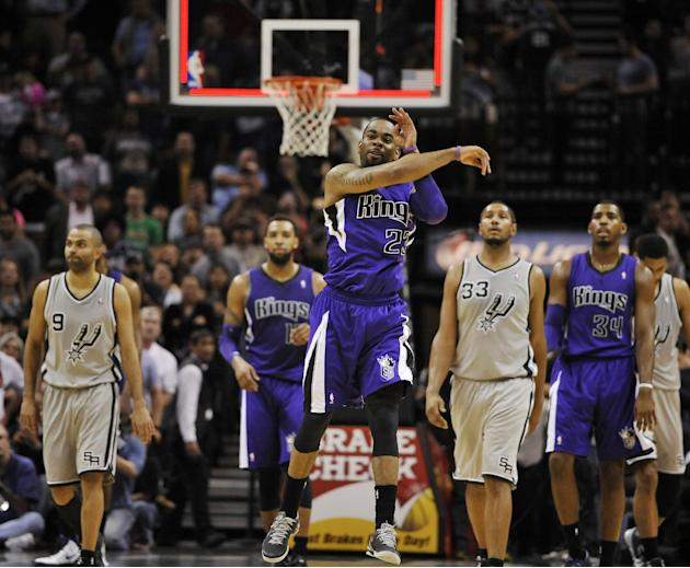 Sacramento Kings guard Marcus Thornton, center, reacts after a Kings shot clock violation in the final seconds of an NBA basketball game against the San Antonio Spurs on Saturday, Feb. 1, 2014, in San