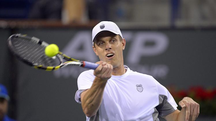 Sam Querrey returns a shot to Novak Djokovic, of Serbia, during their match at the BNP Paribas Open tennis tournament, Thursday, March 14, 2013, in Indian Wells, Calif. (AP Photo/Mark J. Terrill)