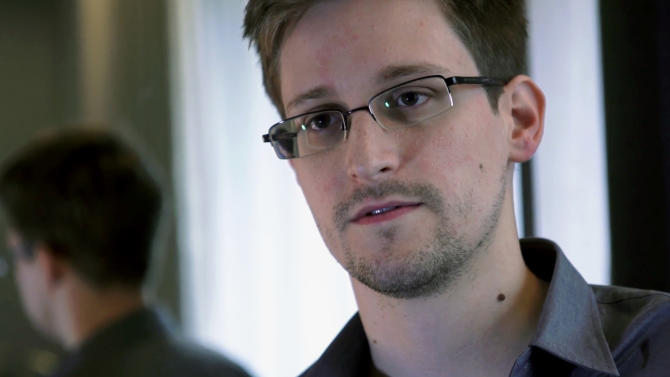 FILE - A Sunday, June 9, 2013, file photo provided by The Guardian newspaper in London shows Edward Snowden, who worked as a contract employee at the U.S. National Security Agency, in Hong Kong. The U.S. government's efforts to determine which highly classified materials Snowden took from the National Security Agency have been frustrated by Snowden's sophisticated efforts to cover his digital trail by deleting or bypassing electronic logs, government officials tell the AP. Such logs would have showed what information Snowden viewed or downloaded. (AP Photo/The Guardian, File)
