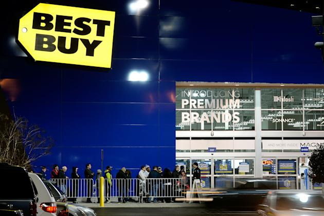 Bargain-hunters line up for door-buster sales at a Best Buy store just before midnight on Thanksgiving Day, Thursday, Nov. 28, 2013, in Dunwoody, Ga. Instead of waiting for Black Friday, which is typically the year's biggest shopping day, more than a dozen major retailers opened on Thanksgiving this year. The store opened at 6 p.m. on Thanksgiving; the line was for particular sales items. (AP Photo/David Tulis)