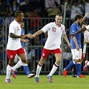 Jagielka, Defoe score as England beats Italy 2-1 The Associated Press Getty Images Getty Images Getty Images Getty Images