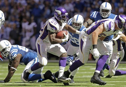 Vinatieri, Luck lead Colts past Vikings 23-20