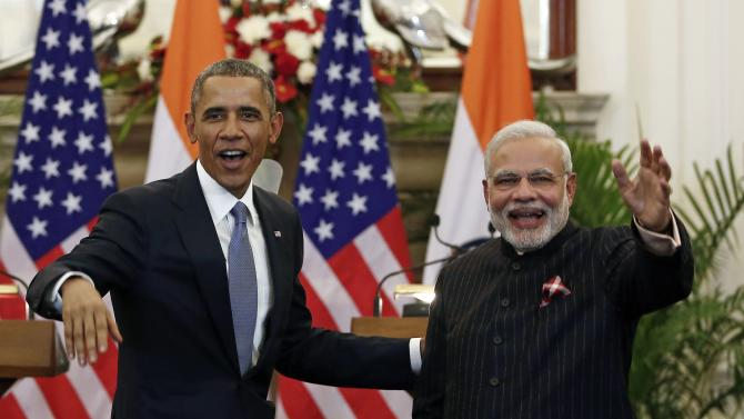 U.S. President Barack Obama stands next to Indian Prime Minister Narendra Modi as they leave after giving their opening statement in New Delhi