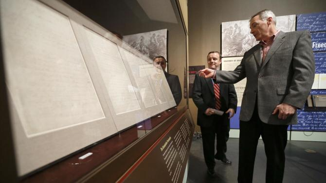 Wayne Moore, right, looks over the Emancipation Proclamation with the help of Jeff Sellers, left, the curator of education at the Tennessee State Museum on Monday, Feb. 11, 2013, in Nashville, Tenn. The document is at the museum in conjunction with an exhibit titled Discovering the Civil War from the National Archives. The papers will only be on view for 72 hours, which is being spread over seven days. It is scheduled to go on view to the public Tuesday, Feb. 12, and close Monday, Feb. 18. (AP Photo/Mark Humphrey)
