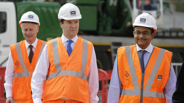 Britain's Chancellor of the Exchequer George Osborne, center, accompanied by India's Finance Minister Palaniappan Chidambaram, right, tour the Pudding Mill Lane Crossrail construction site, in east London, Thursday, May 16, 2013. (AP Photo/Lefteris Pitarakis, Pool)