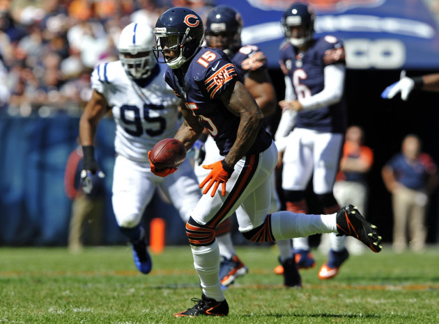 Chicago Bears wide receiver Brandon Marshall (15) runs after a reception as Indianapolis Colts defensive end Fili Moala (95) pursues during the first half of an NFL football game in Chicago, Sunday, Sept. 9, 2012. (AP Photo/Jim Prisching)