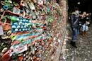 "The likeness of an American flag made from pieces of gum sticks to a wall at Seattle's ""gum wall"" at Pike Place Market, Monday, Nov. 9, 2015. On Tuesday, a steam-cleaning process to remove all of the gum from the walls is scheduled to begin, the first full cleaning the quirky tourist attraction has received in 20 years. (AP Photo/Ted S. Warren)"
