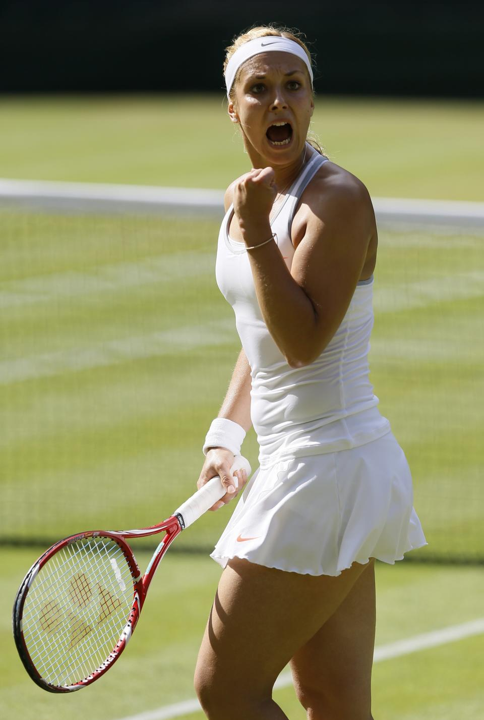 Sabine Lisicki of Germany reacts during her Women's singles semifinal match against Agnieszka Radwanska of Poland at the All England Lawn Tennis Championships in Wimbledon, London, Thursday, July 4, 2013. (AP Photo/Kirsty Wigglesworth)
