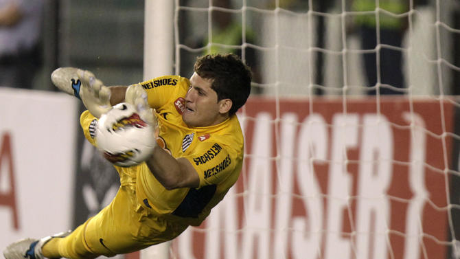 FILE - In this May 24, 2012, file photo, Brazil's Santos' goalkeeper Rafael stops a shot in the penalty shootout of a Copa Libertadores soccer match in Santos, Brazil.  The Brazilian football federation says starting goalkeeper Rafael has been dropped from the men's Olympic squad after injuring his right elbow in practice. (AP Photo/Andre Penne, File)