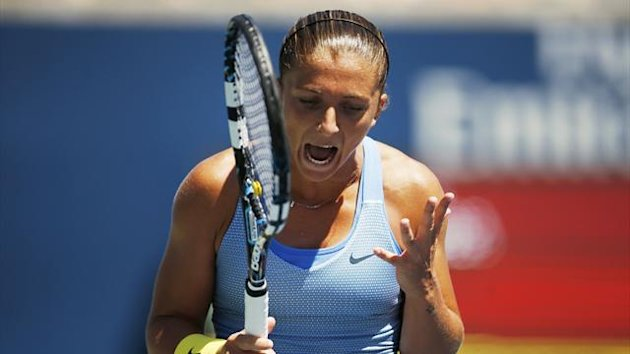 Sara Errani of Italy reacts to missing a point (Reuters)