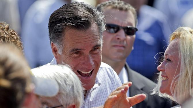 Republican presidential candidate, former Massachusetts Gov. Mitt Romney greets supporters following a campaign stop in Council Bluffs, Iowa, Friday, June 8, 2012. (AP Photo/Nati Harnik)