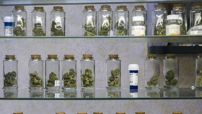 In this photo taken Tuesday, May 14, 2013, Medical marijuana vials are displayed at the Venice Beach Care Center medical marijuana dispensary in Venice, Calif. Los Angeles politicians have tried and failed for so long to regulate medical marijuana that it was only a matter of time before voters got a chance to control shops that have proliferated. (AP Photo/Damian Dovarganes)
