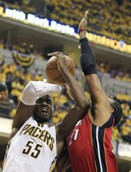 Indiana Pacers&#39; Roy Hibbert (55) is fouled by Miami Heat&#39;s Ronny Turiaf during the second half of Game 3 of their NBA basketball Eastern Conference semifinal playoff series, Thursday, May 17, 2012, in Indianapolis. Indiana won 94-75. (AP Photo/Darron Cummings)
