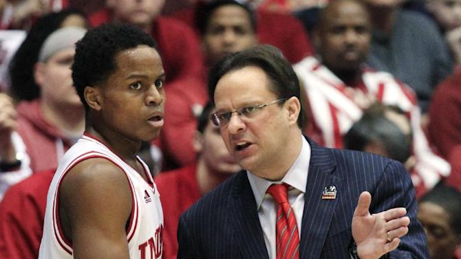 Indiana guard Yogi Ferrell talks with head coach Tom Crean in the first half of a third-round game of the NCAA college basketball tournament against Temple, Sunday, March 24, 2013, in Dayton, Ohio. (AP Photo/Skip Peterson)
