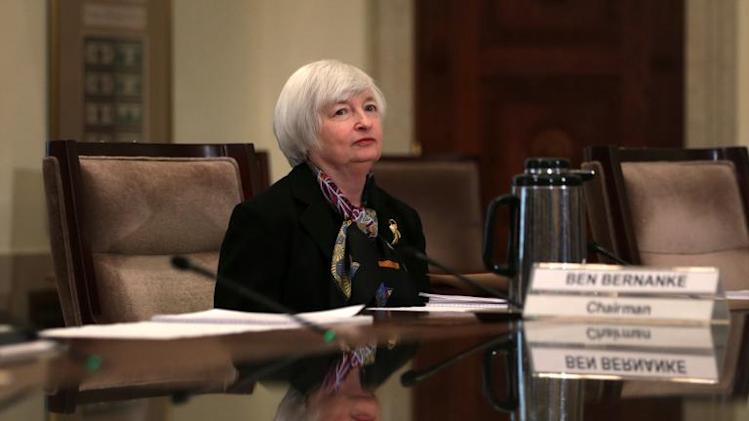 Janet Yellen, vice chair of the Federal Reserve Board and President Barack Obama's nominee to succeed Chairman Ben Bernanke, waits for the beginning of a meeting December 10, 2013 in Washington, DC