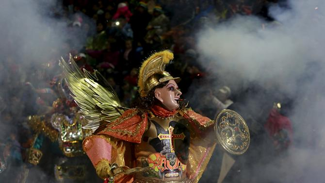 An angel a character of Diablada Ferroviaria group performs during the carnival parade in  Oruro