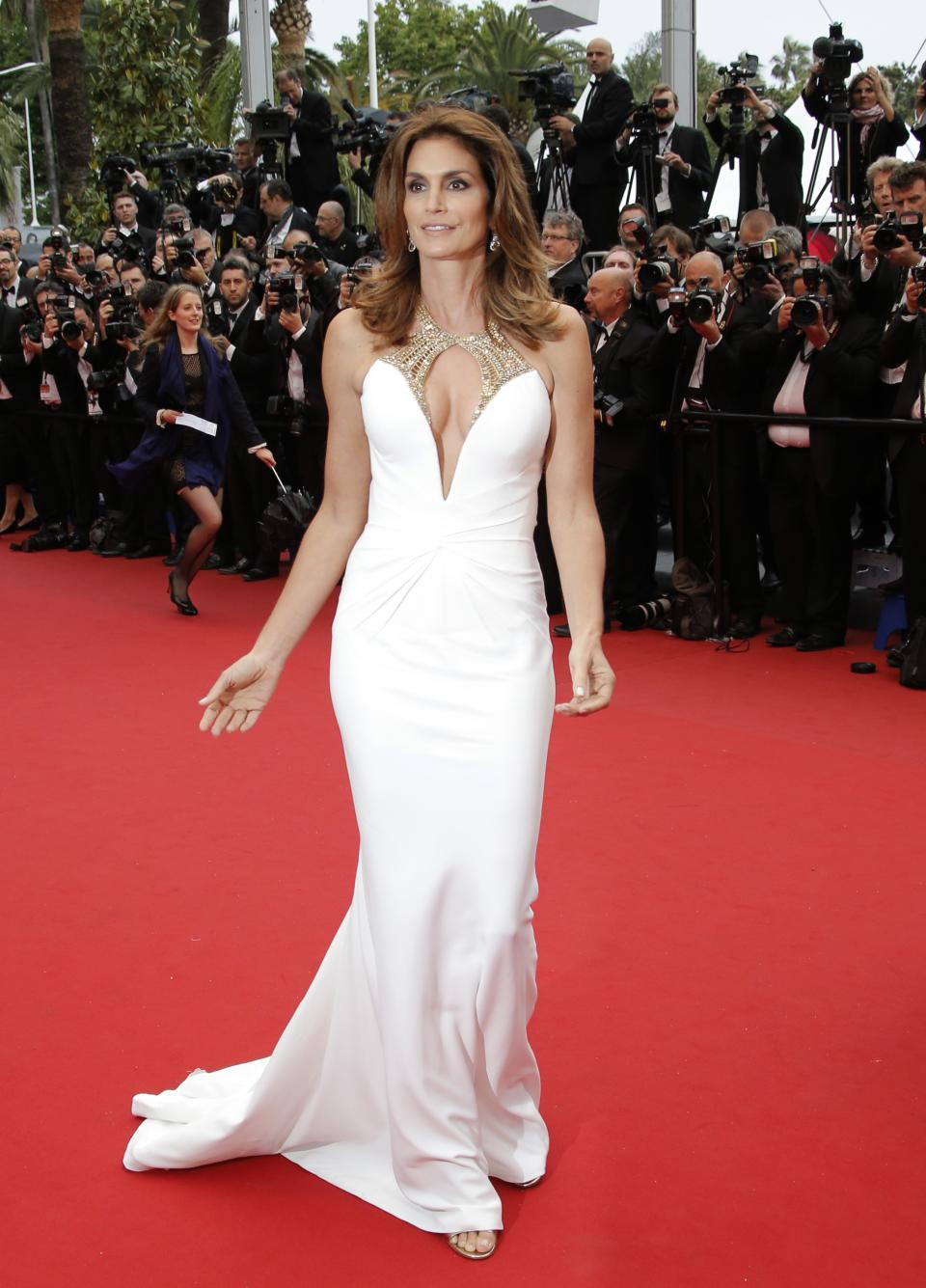 FILE - This May 15, 2013 file photo shows model Cindy Crawford wearing a Roberto Cavalli white gown with plunging beaded neckline as she arrives for the opening ceremony and the screening of The Great Gatsby at the 66th international film festival, in Cannes, southern France. (AP Photo/Francois Mori)