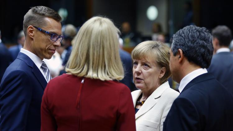 European leaders hold a discussion at the start of a European Union summit in Brussels