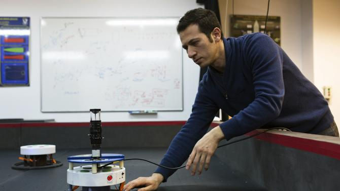 Researcher handles an autonomous robot used to test technology for the Adelis-SAMSON project, in Haifa