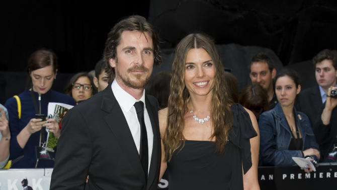 British actor, Christian Bale and Sandra Bale arrive for the European premiere of The Dark Knight Rises, at a central London cinema, Wednesday, July 18, 2012. (AP Photo/Jonathan Short)