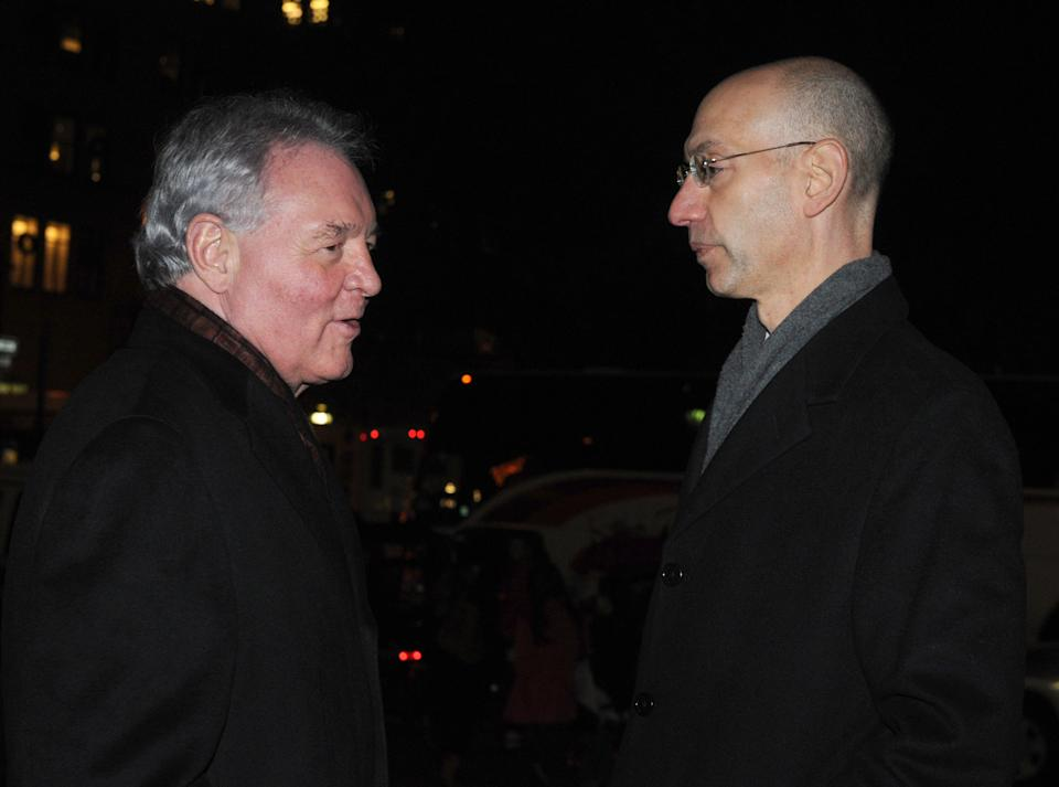 San Antonio Spurs owner Peter Holt, left, and NBA deputy commissioner Adam Silver converse in front of a midtown office building where NBA labor negotiations are taking place in New York, Friday, Nov. 25, 2011. (AP Photo/ Louis Lanzano)