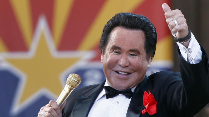 """FILE - In this Feb. 14, 2012 file photo, Entertainer Wayne Newton performs during the 100th Anniversary celebration of Arizona's statehood, at the Capitol in Phoenix. The company that purchased the rights to convert Newton's home into """"Graceland West"""" filed a lawsuit this week in Las Vegas against Newton, his wife and her 76-year-old mother that claims the family unreasonably delayed the project to ensure it never opens. (AP Photo/Matt York, File)"""