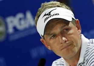 Luke Donald, of England, answers a question during a news conference at the PGA Championship golf tournament Tuesday, Aug. 9, 2011, at the Atlanta Ath